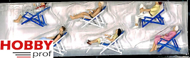 Resting people in deck chairs